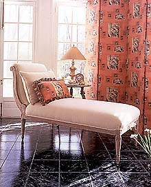A chaise longue.  Read an article on bedroom decorating (you never know - you might find it interesting!).