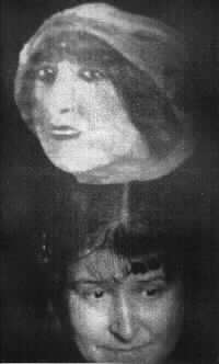 The head of actress Monna Delza appearing as ectoplasm above medium Eva C's head (or so you are supposed to believe).  From about 1920.