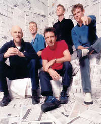 Who are these people?  Midnight Oil, a socially and environmentally conscious band from Australia.  Bonza!